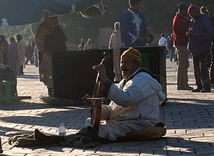 Man playing the violin in a plaza in Marrakech...