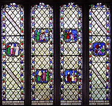 Photo of colourful stained class window showing human figures