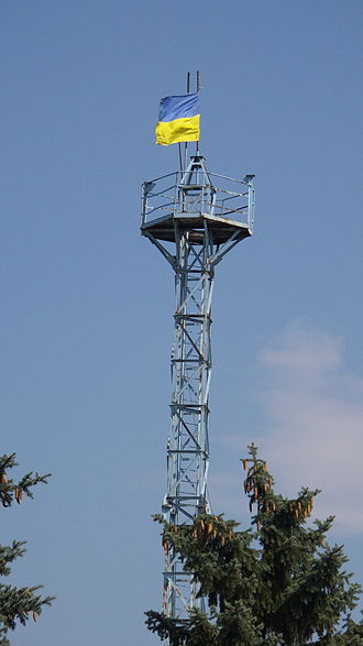 Marinka, Ukraine - August 2014: Ukrainian flag over the radio tower in Marinka