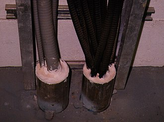Penetrant (mechanical, electrical, or structural) - Image: Mcc room perimeter canned cable penseal metacaulk