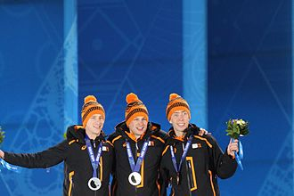 Sven Kramer - Sven Kramer (center) won gold at the 5000 m in Sochi.