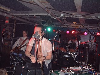 Mike Patton - Mike Patton performing with a gas mask during a Tomahawk show in 2002.