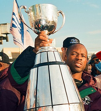 Mike Pringle (Canadian football) - Pringle holding the Grey Cup, 1995