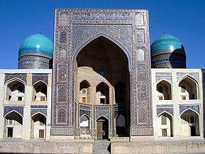 Iwan - Multiple iwans and tiled domes of the 16th century Persian-style Mir-i-Arab madrasa, Bukhara, Uzbekistan
