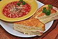 Mmm... grilled ham and Swiss with tomato soup (6897834667).jpg