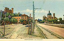 Montichiari, via Umberto I - cartolina colorata con la stazione tranviaria
