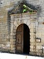 Montignac (24) St Georges portail.JPG