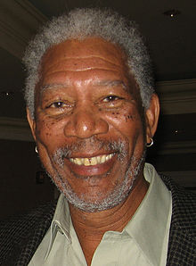Morgan Freeman headshot facing the camera and smiling