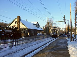 Mountain Avenue station - An afternoon train leaving Mountain Avenue station in February 2015. The 1893 station depot, constructed by the Erie Railroad is on the left.