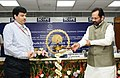 Mukhtar Abbas Naqvi lighting the lamp at the launch of the Interactive Voice Response System (IVRS) of National Minorities Development and Finance Corporation (NMDFC) and inauguration of the Annual Conference of State.jpg