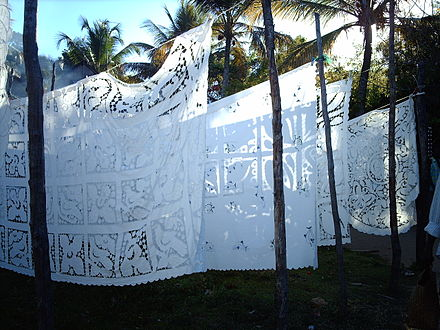 Embroidered tablecloths are produced for sale to tourists at Nosy Komba. NappesNosyKomba.JPG
