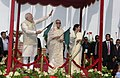 Narendra Modi and the Prime Minister of Bangladesh, Ms. Sheikh Hasina fagging off the Dhaka-Shillong-Guwahati bus service, in Dhaka, Bangladesh. The Chief Minister of West Bengal, Kumari Mamata Banerjee is also seen (1).jpg