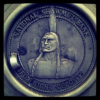 FleetBoston Financial - A night deposit box for National Shawmut Bank displaying the company symbol Chief Obbatinewat, located at a current Bank of America location in Boston.