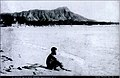 Native Hawaiian surfer seated with alaia board.jpg