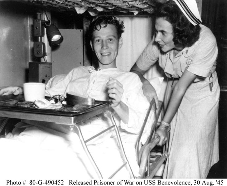 File:Navy nurse and released POW on USS benevolence, August 1945 highres.jpg