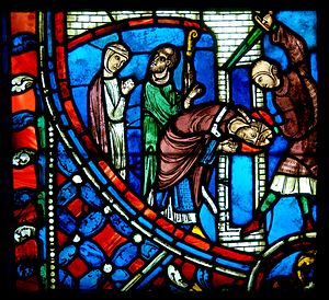 Nicasius of Rheims - Martyrdom of St. Nicasius: Scene from the life of St. Nicasius. Stained glass window from a chapel of the cathedral of Soissons (Picardy, France), early 13th century.