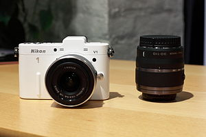 Nikon 1-mount - Nikon V1 with 10-30mm zoom fitted, and 30-110mm zoom to one side