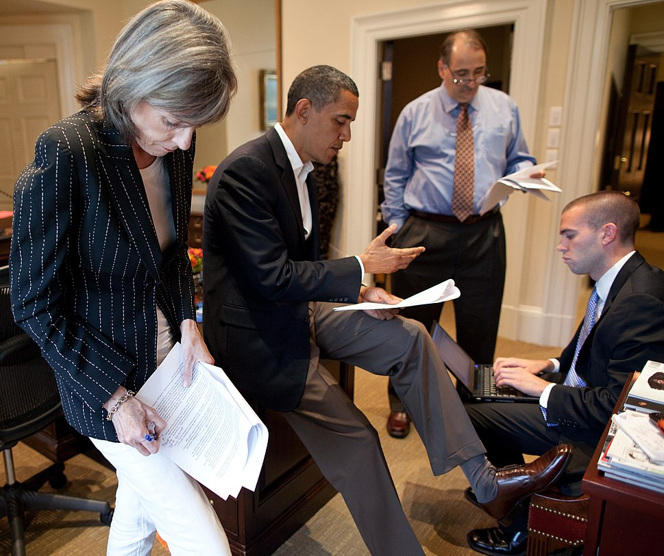 Obama and aides working on a speech cropped