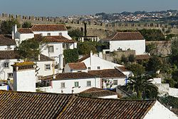 The medieval wall of the Castle of Óbidos dividing the town from the rest of the municipality