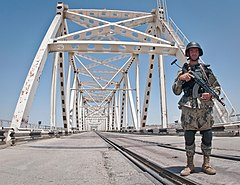 Officer of the Afghan Border Police at the Afghanistan–Uzbekistan Friendship Bridge.jpg