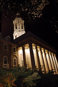 Old Main, the main administrative building at Penn State University Park, at night.