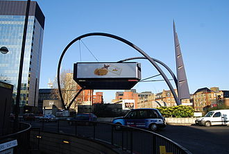 Old Street Roundabout - An urban sculpture and advertising hoarding in the centre of Old Street Roundabout, pictured from the south side looking north.