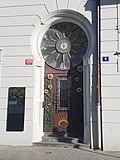 Old door with flower motif and clock.jpg