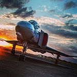 "Our McDonnell Douglas F-4C Phantom II outside of Hangar 79 during the final minutes of ""magic hour."" Sunsets on Ford Island are magical -pearlharbor -aviation -avgeek -pilot (9020804266).jpg"