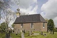 Overzicht van de zuidgevel met dakruiter, kerkhof op de voorgrond - Tirns - 20399800 - RCE.jpg