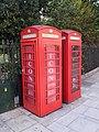 Pair Of K6 Telephone Kiosks Adjacent To Boundary Railings And Gates.jpg