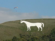 Figure of a white horse cut into the hillside.