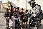 Paratroopers deliver soccer equipment to Rusafa DVIDS173727.jpg