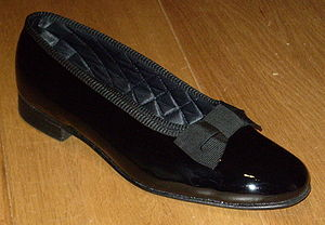 Court shoe - A men's court shoe (or opera pump), in patent leather, worn with white tie or black tie attire.