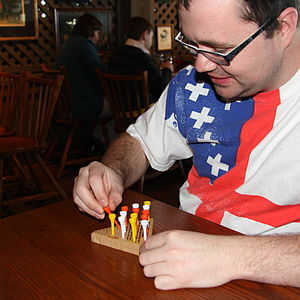 Peg solitaire - A man playing peg solitaire (triangular variant)