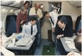 Photograph of President Reagan putting a golf ball around Air Force One - NARA - 198571.tif