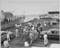 Photograph of President Truman and members of his vacation party leaving the dock at Key West, Florida, following... - NARA - 200608.tif