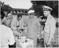 Photograph of President Truman serving himself a picnic lunch during his tour of Fort Jefferson National Monument. - NARA - 200595.tif