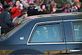 President Barack H. Obama, foreground, waves to the crowd from his limo during the inaugural parade in Washington, D.C 130121-D-FW736-015.jpg