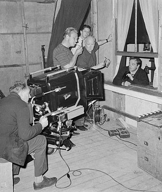 Paul Rotha - Rotha (center, holding glasses) while filming The Silent Raid in the Netherlands in 1962