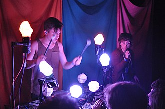 Purity Ring (band) - Corin Roddick (left) and Megan James (right) performing live in 2012.