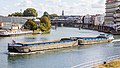 Pushtow, one cargo barge Mechta and barge Ponto at Confluence of the Seine and Marne rivers-1981.jpg