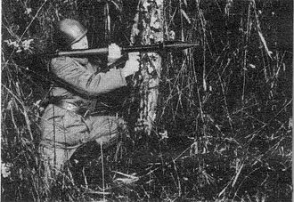 RPG-2 - A Polish soldier with an RPG-2 launcher.