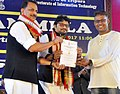 Rajiv Pratap Rudy and the Minister of State for Heavy Industries & Public Enterprises, Shri Babul Supriyo presented the the certificates at the inauguration of the DigiDhan Mela, in Agartala (1).jpg
