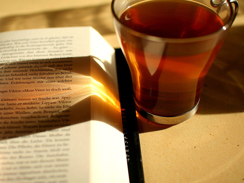 File:Reading and drinking tea - sunlight.jpg