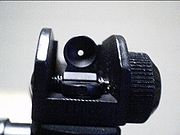 Looking down the iron sight of an ArmaLite M15A4 Carbine (a civilian copy of the M4 Carbine)