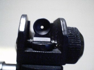 "Diopter sight - Civilian AR-15 target sights have an aperture between 1 to 1.15 mm (0.040-0.045""). The aperture on AR-15 military sights have a day aperture of approximately 1.8 mm (0.070""), and also a night setting with a larger 5 mm aperture (0.200""), and as such the military sight is not strictly a diopter sight in either setting."