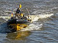 Rigid-hulled inflatable speedboat under Tower Bridge 01.jpg