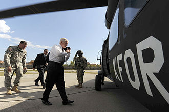 Robert Gates - Gates boards a UH-60 Blackhawk, Camp Monteith, Kosovo