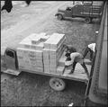 Rohwer Relocation Center, McGehee, Arkansas. Evcauees loading trucks with supplies for transportati . . . - NARA - 538911.tif