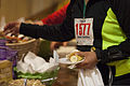 Runners receive breakfast after completing the Marine Corps Community Services St. Patrick's Day 5K Fun Run aboard Marine Corps Air Station Beaufort, S.C., March 13, 2014 140314-M-VR358-059.jpg